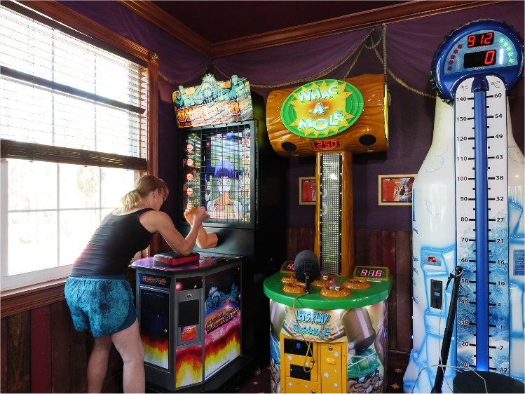Play whack-a-mole, skeeball, and other carnival midway games in this luxury vacation retreat rental near Orlando