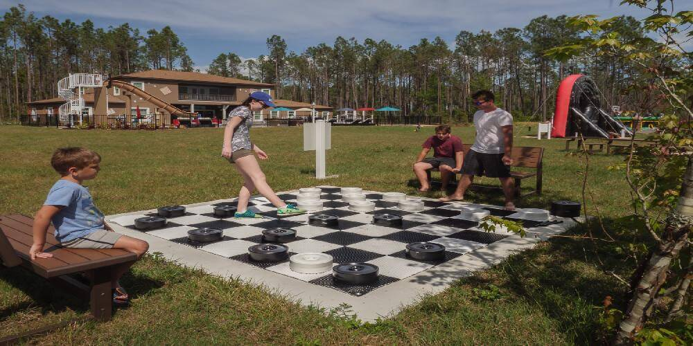Play outdoor lawn checkers and giant connect 4